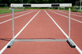 Hurdle one on the stadium Royalty Free Stock Photo