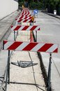 Hurdles in the construction site during the roadworks for the la many laying power line cables Royalty Free Stock Photos