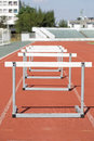 Hurdles on the red running track prepared for competition Stock Photo