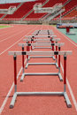 Hurdles on red running track in stadium the prepared for competition Stock Images