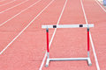 Hurdles on the running track in stadium red prepared for competition Stock Photography