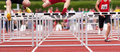 Hurdles sprint in track and field Stock Photography