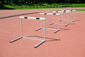 Hurdles on the stadium four Stock Photography
