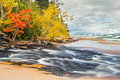 Hurricane meets superior michigan s river flows across the beach and into lake at pictured rocks national lakeshore Royalty Free Stock Photography