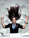 Hurricane paper leaves flying around the girl in the office Stock Images
