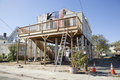 Hurricane sandy year later highlands a house has been raised up and put on stilts in the new jersey a sign saying thank you Stock Image