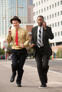 Hurrying Businessmen Stock Photography