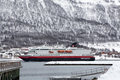 Hurtigruten ship entering tromso harbour norway march is a norwegian passenger and freight line with daily Stock Photos