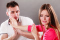 Husband apologizing wife angry upset woman mad women refuses apology pushing him away boyfriend trying to convince girlfriend man Stock Image
