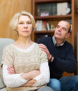 Husband asking wife for forgiveness guilty senior at home Stock Photography