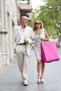 Husband goes shoping with his wife Royalty Free Stock Photo