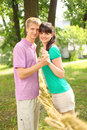 Husband hold hands of wife near braided straw Royalty Free Stock Photography