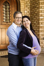 Husband holding pregnant wife. Stock Photo