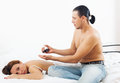 Husband massaging the back of his woman women in bed Stock Photo
