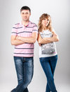 Husband and pregnant wife stand close to each other at studio portrait of Stock Photo