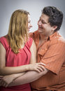 Husband telling a secret to his wife Royalty Free Stock Images