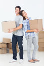 Husband and wife carrying boxes in their new house happy Stock Photo