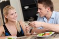 Husband and wife have romantic supper in the kitchen Royalty Free Stock Photos