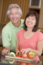 Husband And Wife Preparing meal,mealtime Together Royalty Free Stock Photography