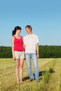Husband, wife stand in field Royalty Free Stock Images