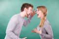 Husband and wife yelling and arguing. Royalty Free Stock Photo