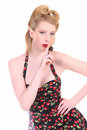Hush pretty blond pinup girl in a rockabilly cherry stem print dress Royalty Free Stock Image