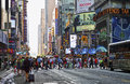 Hustle bustle manhattan crowds of people at an intersection in times square during rush hour in Stock Photo