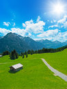 Hut and alpine landscape a wooden with beautiful Royalty Free Stock Images