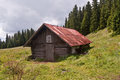 Hut called hotel choc on stredna polana meadow chos in chocske vrchy mountains below velky hill Stock Photos