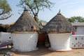 Hut of indian village typical clay buildings in sar rajasthan india Royalty Free Stock Photo
