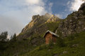 Hut in mountains small lone alp Stock Photo