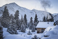 Hut in the mountains surrounded by fir trees Royalty Free Stock Photography