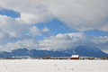 Hut and mountains in winter landscape with romania at bran Royalty Free Stock Photography