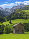 Hut in the mountains wooden surrounded by beautiful alpine landscape Royalty Free Stock Image