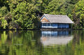 Hut near the lake on reflected Royalty Free Stock Photo