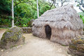 Hut and sacrificial figures waimea valley oahu hawaii Stock Photography