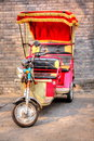 Hutong pedicab china peiking is a special scenery the driver are carrying tourists walking in the and telling stories about Stock Image
