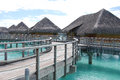 Huts bridge to on bora bora Stock Photo