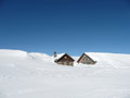 Huts in deep snow on the Alps with copy-space Stock Photo