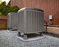 Hvac heating and air conditioning residential units conditioner compressor near suburban house Stock Images