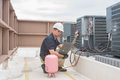 HVAC Technician with panel Royalty Free Stock Photo