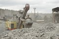 Hydraulic digger power working in quarry caterpillar Stock Photography