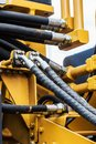 Hydraulics tractor yellow. Royalty Free Stock Photo