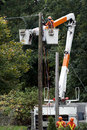 Hydro Workers replace a utility pole Royalty Free Stock Photo