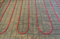 Hydronic heating pex tubing on a floor for with reinforcing mesh ready for concrete Royalty Free Stock Photos