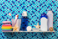 Hygiene products on shelf in bathroom Royalty Free Stock Photo