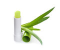 Hygienic lipstick with aloe leaf Royalty Free Stock Images