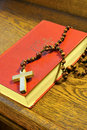 Hymnal  book and wooden rosary bead Royalty Free Stock Images