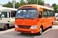 Hyundai county ufa russia may orange small city bus at the city street Royalty Free Stock Photos