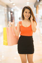 I�m in the mall dear vertical image of a young woman talking by cell shopping Stock Photos